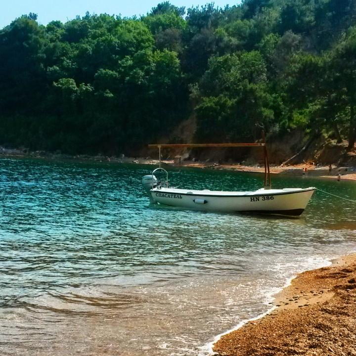 Moored boat on Mogren beach in Montenegro