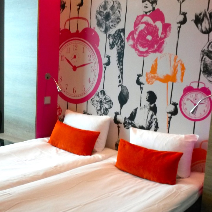 Brightly coloured bedrooms at Motel L in Stockholm