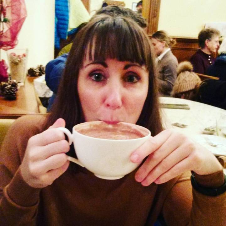 Louise drinking hot chocolate at Cafe Piemonte in Munich