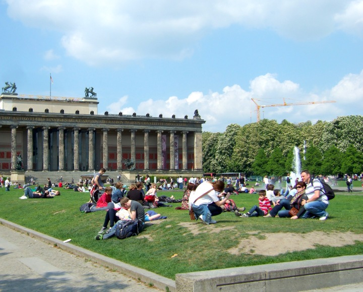 People sitting on the grass in the area around the Berliner Dom