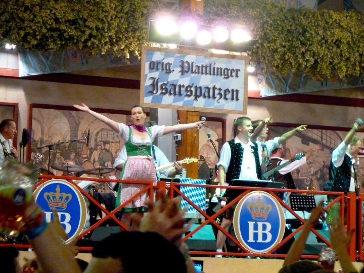 People singing in the Hofbrau Festzelt at the Oktoberfest