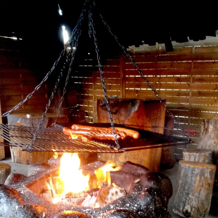 Sausages on an open fire at Karczma Smil'y